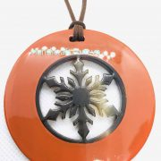 Orange lacquer and horn pendant